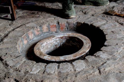 Kvevri pots in the floor with wine, Telavi