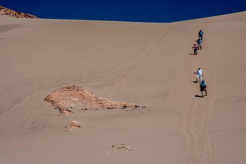 Walking down the dunes near San Pedro de Atacama, Chile