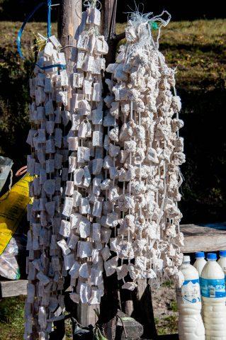 Ropes of hard cheese on Tibetan roadside stalls near Thimphu, Bh