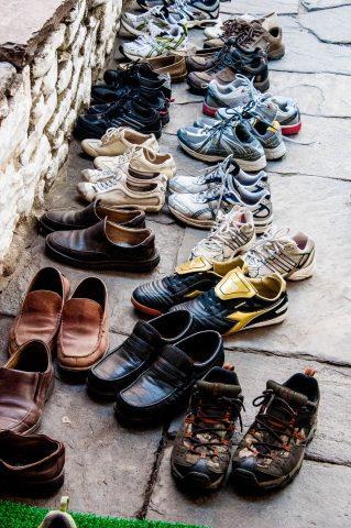 Visitor's shoes, The Kurje Monastic Complex, Bhutan