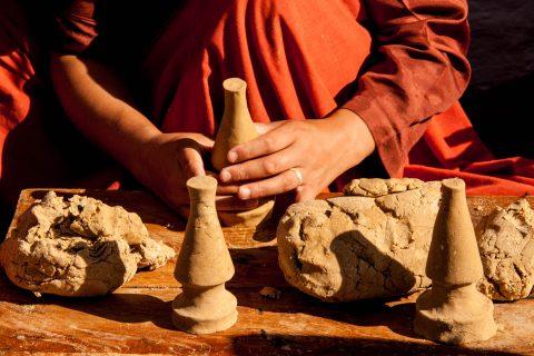 Making clay offerings at Sangchhen Nunnery, Punakha, Bhutan
