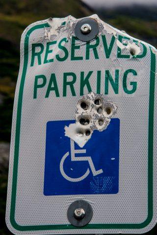 Bullet damaged sign, Valdez, Alaska