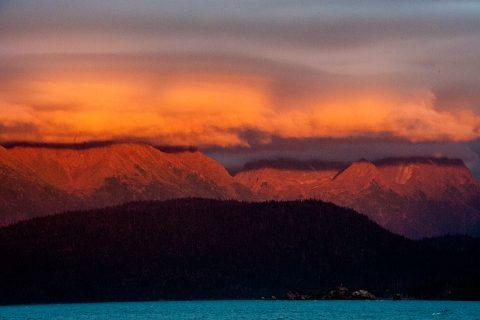 Sunset across Kachemak Bay from hotel on Homer Spit, Alaska