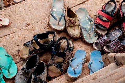 Shoes at entrance, Akha village, Laos