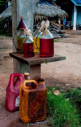 Petrol for sale,  Akha village, Laos