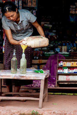 Selling petrol, Akha village, Laos
