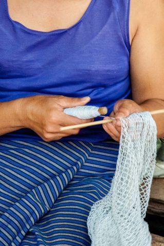 Making a net, Akha village, Laos