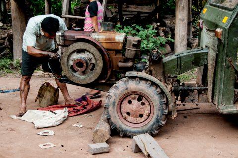 Repairing the tractor,  Akha village, Laos