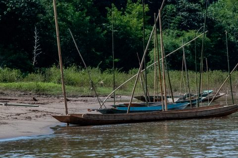 Boats moored on banks of Nam Ou River, Laos