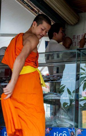 Monk in market, Luang Prabang, Laos
