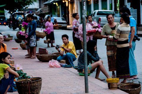 Waiting to give breakfast alms, Luang Prabang, Laos