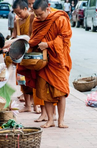 Receiving breakfast alms, Luang Prabang, Laos