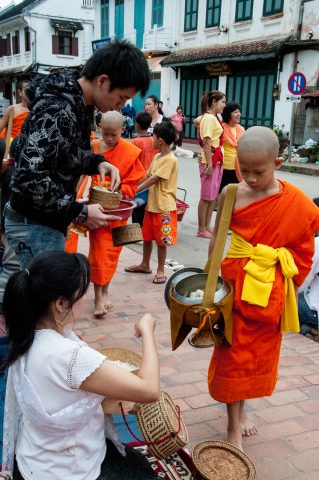 Giving  & receiving breakfast alms, Luang Prabang, Laos
