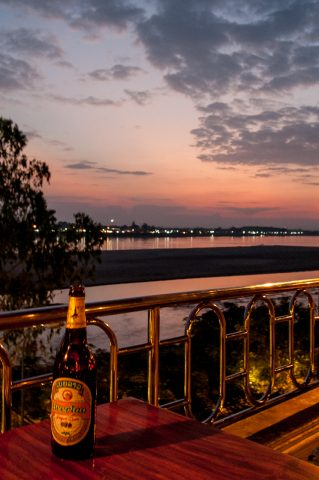 Local beer at sunset over Mekong, Vientiane, Laos