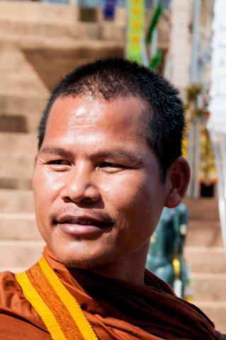 Monk at Phra Chiang Saen Si Phaendin,  Golden Triangle, Thailand