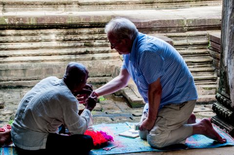 Receiving bracelet at Angkor Wat