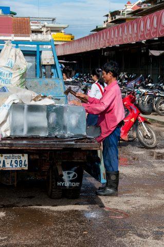 Ice man at market, Battambang